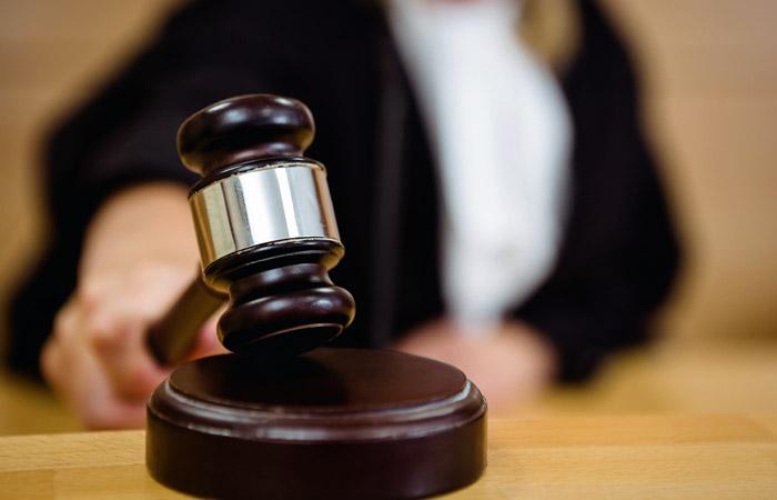 До суду передали справу прикарпатця, який займався грабежами, вимаганням та збутом підробленої валюти